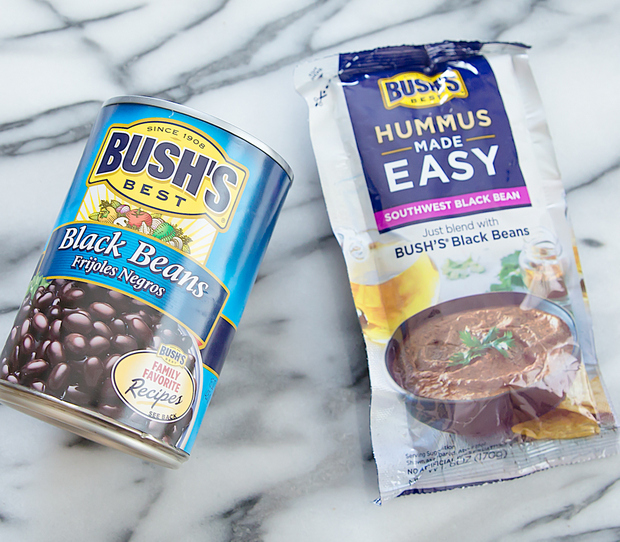 overhead photo of a can of black beans and a package of hummus made easy