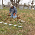 George raises his great-great-grandfather's footstone