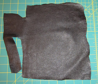 a piece of black leather