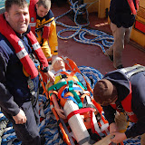 The casualty (a dummy!) is strapped securely to the stretcher for transfer - Training exercise, 19 February 2012