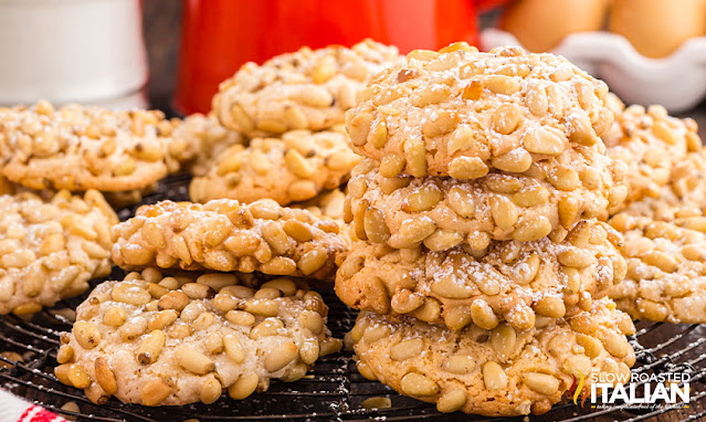 italian pine nut cookies piled on a cooling rack