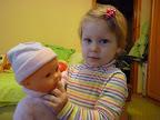 Ну мы особо не играем куклами - чисто попозировать :) и палец кукле в рот :) Два года и 2.5 месяца
