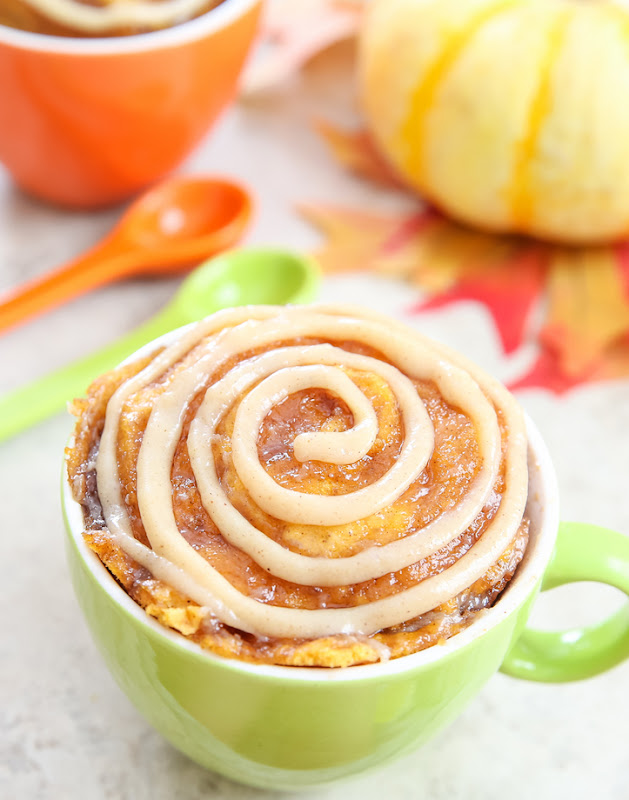 photo of a Pumpkin Cinnamon Roll Mug Cake in a green mug