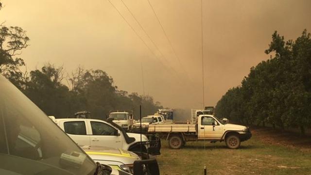Smoke from a 50km-long bushfire in Queensland, Australia darkens the sky, 26 November 2018. Photo: Queensland Ambulance Service