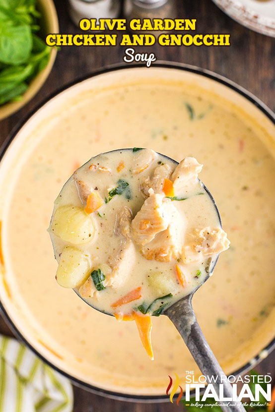 Olive Garden Chicken and Gnocchi Soup spoonful of soup over a pot of soup