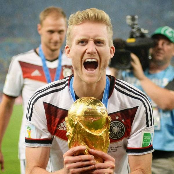 Andre Schuerrle of Germany celebrates with the World Cup trophy after winning the FIFA World Cup 2014 final soccer match between Germany and Argentina at the Estadio do Maracana in Rio de Janeiro, Brazil, 13 July 2014.