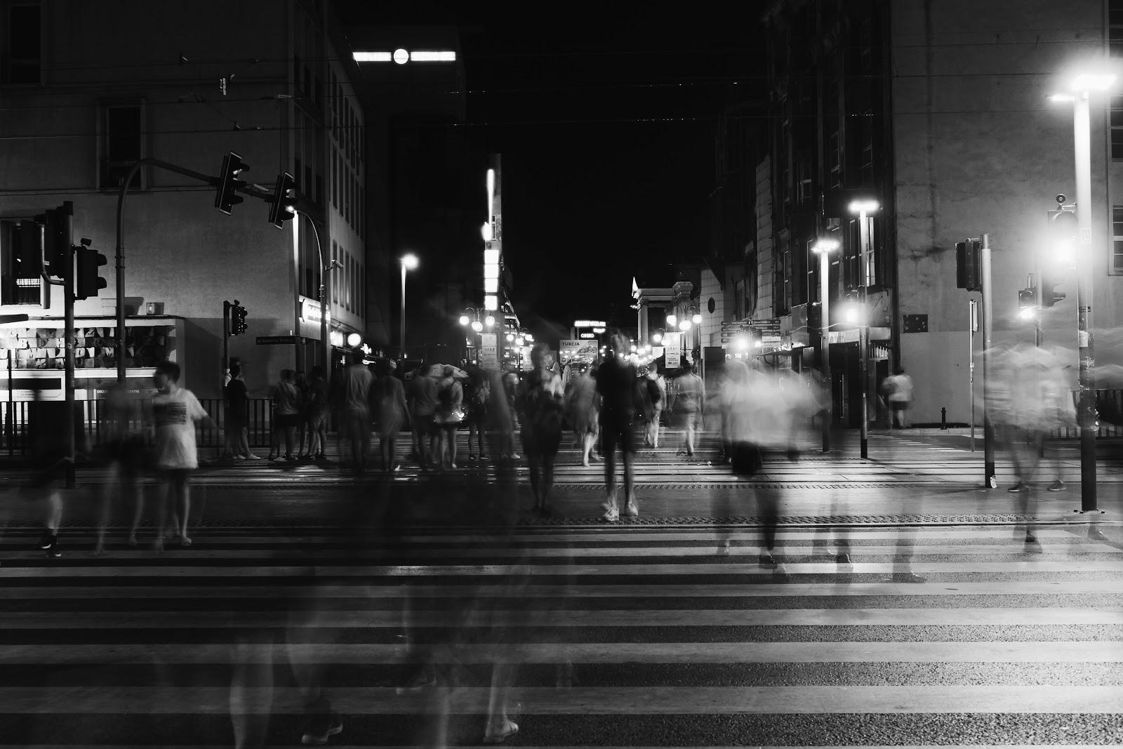 time lapse photography of people who are in the street