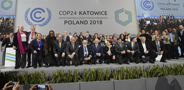 Heads of delegations react at the end of the final session of the COP24 summit on climate change in Katowice, Poland, Saturday, 15 December 2018. Photo: Czarek Sokolowski / AP Photo