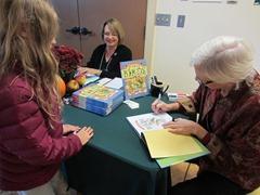 Kim Kurki Book Signing with Fine Artist Joy Kreves looking on November 2014 DR Greenway Jody Ken
