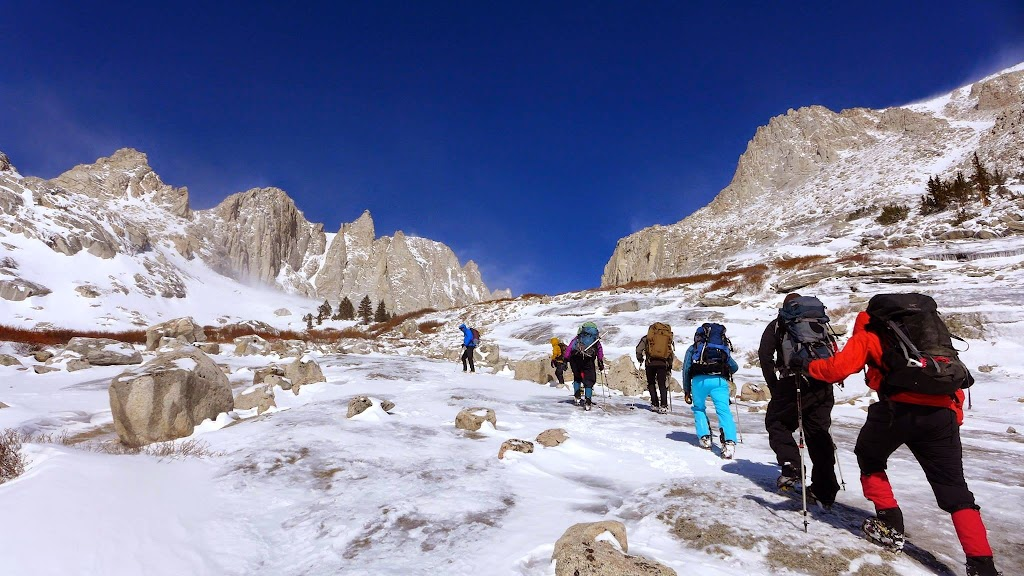"""Shelli, with a group of men and women clients on a climb toward Mt. Whitney. Epic Life partnered with Sierra Mountaineering International for the expedition. We didn't make the summit due to terrible weather and wind and unstable snow on Days 2-3, but it was still a great expedition. (A great quote that summarizes this expedition, and life, in general: """"The journey is for the soul, the ego is for the summit."""")"""