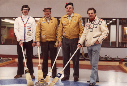 Photo provided by Stephen Girouard of his father, likely taken in the 70s at the Granite Curling Club in Seattle.   From L-R (Unknown, Bob Chapman, Dusty Rhodes, Jerry Girouard)  Note the SFBACC patches and pins.  Jerry Girouard began curling in Manitoba and was a member of the SFBACC in the 70s.
