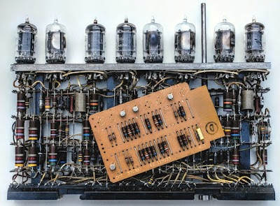 "A tube module implements more logic than an SMS card, but the cards are much smaller and use less power. Photo shows a ""DGT"" SMS card implementing four AND gates on top of a different tube module."