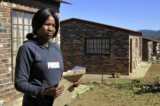 Tsholofelo Molefe of Groot Marico next to her RDP house that she has been denied access to.