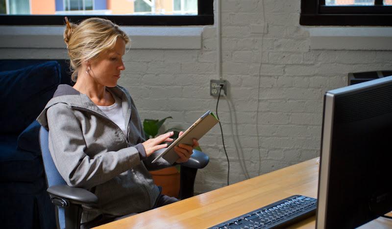 Women's GP Exec Hoodie: Alice peering over computer