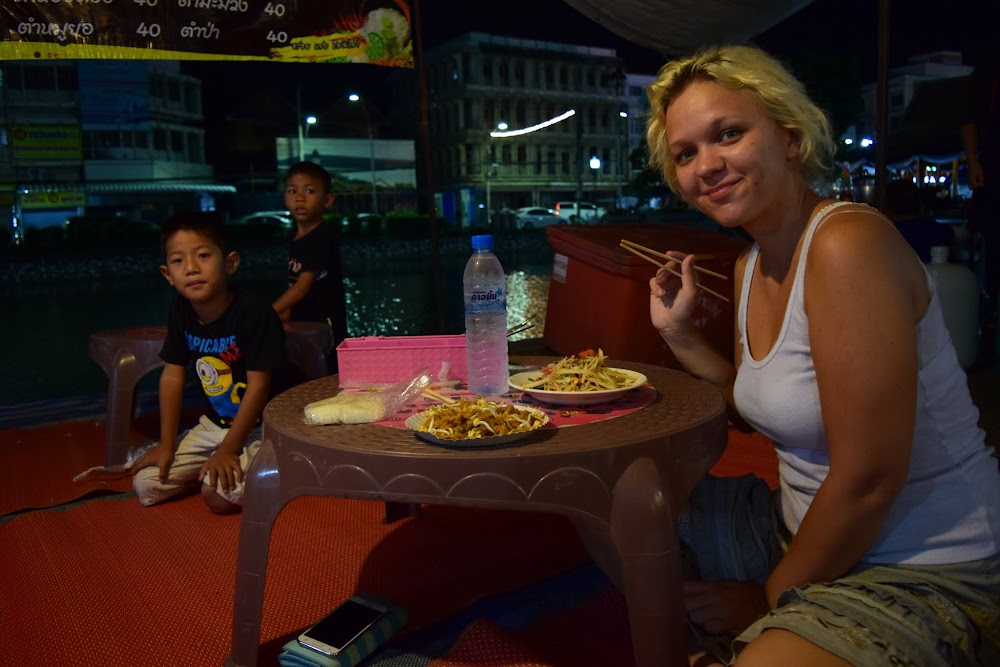 There is a lovely little market right along the side of the moat! Me and Anna stop for a delicious dinner of som tam and their local version of pad thai, sitting on the floor right next to the canal!  A few curious local boys photo-bomb as I snap the pic!