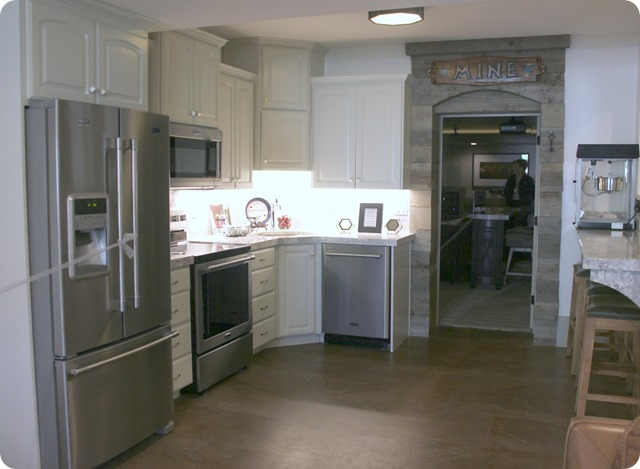white basement kitchen leading to theater room