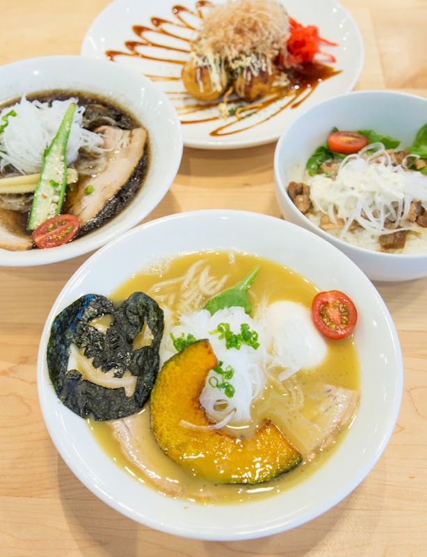 overhead photo of four dishes served at Nishiki Ramen