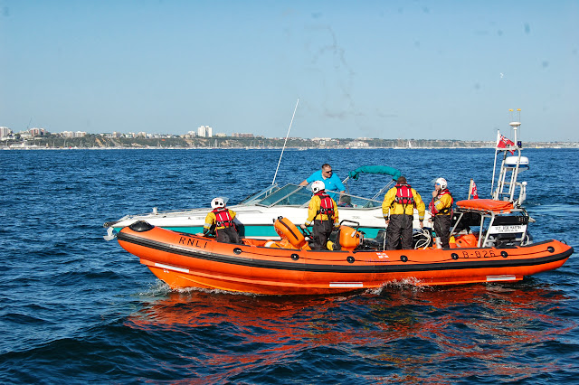 The ILB come alongside a motorboat that had suffered engine failure on Poole Bay.  31 August 2013 Photo: RNLI Poole/Dave Riley
