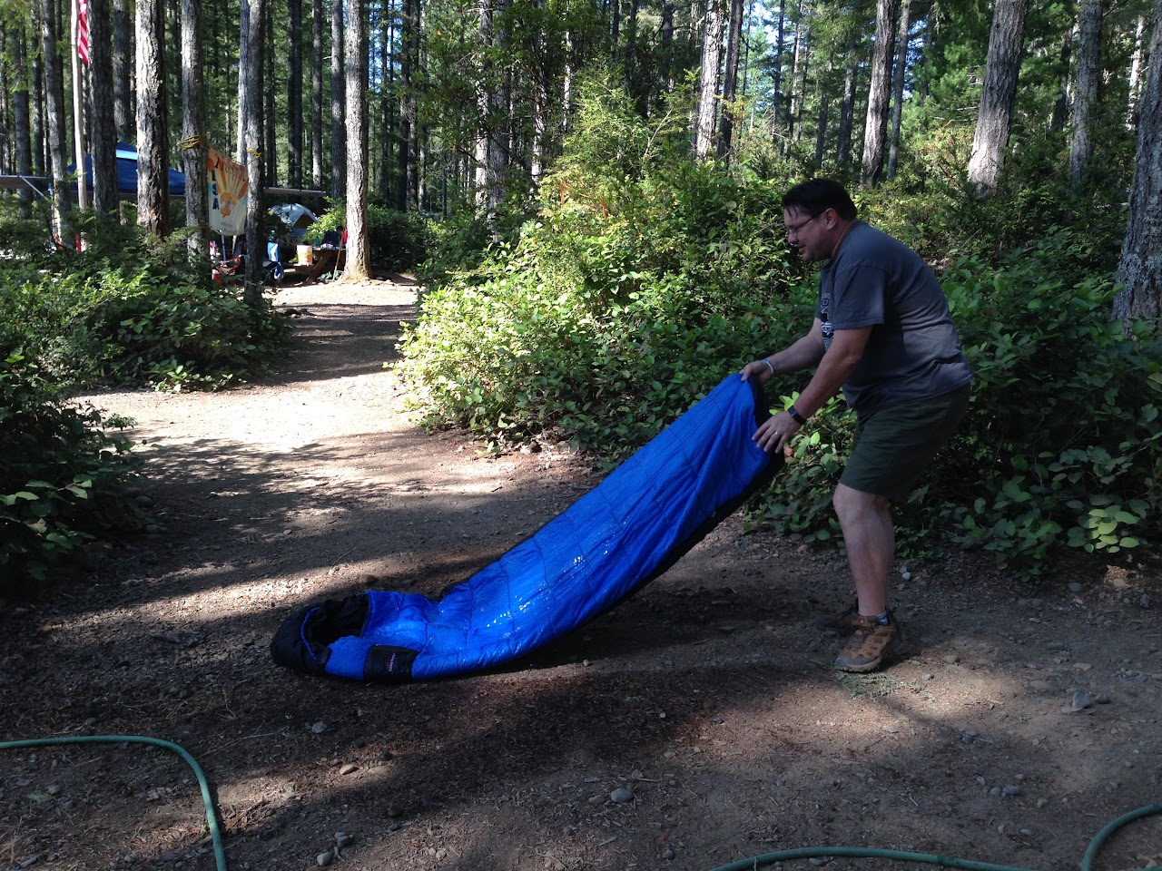 Scoutmaster Kevin helping to clean off the barf...
