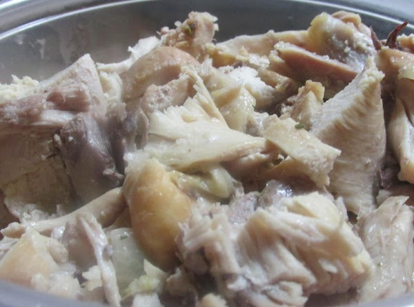 Remove chicken parts from pot with slotted spoon, remove skin and bones and break...
