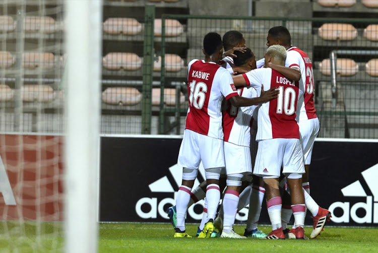 Ajax Cape Town striker Yannick Zakri celebrates with teammates after a scoring a goal during an Absa Premiership match at home against Bidvest Wits at Athlone Stadium on April 11, 2018 in Cape Town, South Africa. Ajax won 1 - 0.