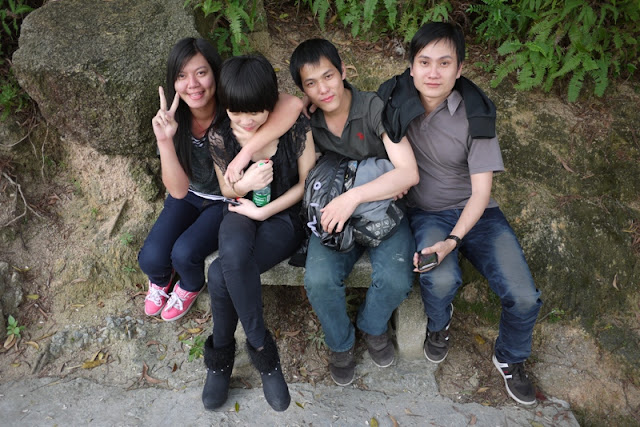 Four people sitting on a bench at Jingshan Park in Zhuhai