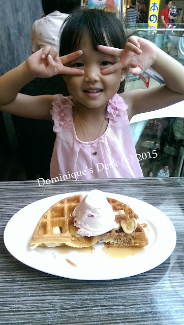 Tiger girl posing with her waffle ice-cream