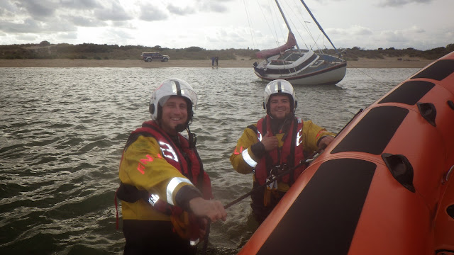 Having checked all was okay, Alex Evans and Lewis Singleton return to the ILB - 5 October 2014.  Photo credit: Poole/RNLI