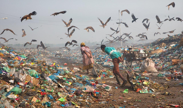 This image, 'Life in Garbage' by M Yousuf Tushar, of Bangladesh, was one of the shortlisted photographs chosen by judges at the London based charity, which is dedicated to water and environmental management. It shows people trying to eke out a living in a landfill site. Photo: M Yousuf Tushar / CIWEM