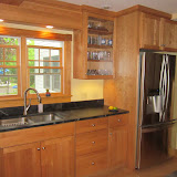 Natural cherry cabinets, sopastone top in a farm house.