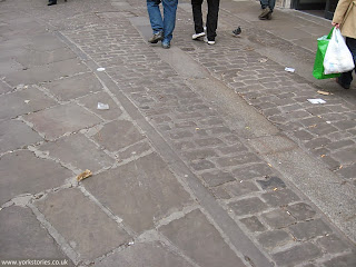 April 2013. Cart tracks, setts and slabs in King's Square