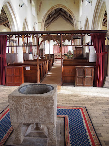 St Margarets interior with font and aisle