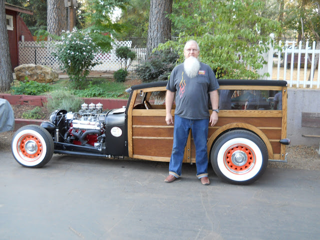 Roger Kirk in his custom Model A woody with 364, 4 speed..