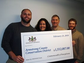 OSM/VISTA Miranda Shoemaker accepts funding for the Armstrong Conservation District after she wrote and received a $1.5 million grant for the organization in Kittanning, PA