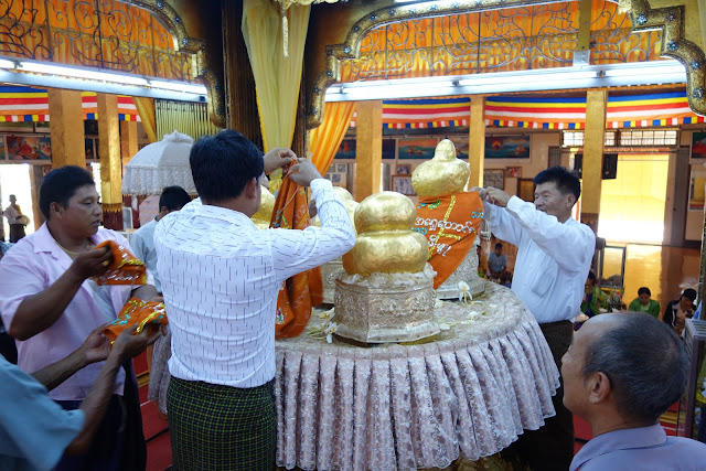 Pressing gold onto Buddha statues at Phaung Daw Oo. From Romping on the Fertile Waters: The Bounties of Inle Lake, Myanmar