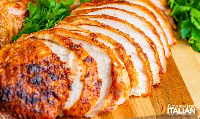 smoked turkey sliced on a cutting board
