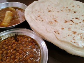 Breakfast in Gilgit (Chickpeas, Payee and roti)