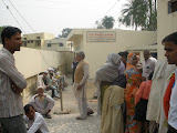 Patients wait outside the new health clinic