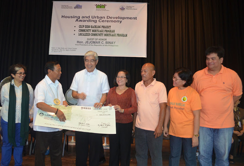 Vice President Jejomar Binay turns over check for Silay mortgage program
