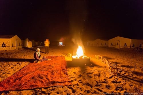 Desert camp by fire light Morocco Sahara