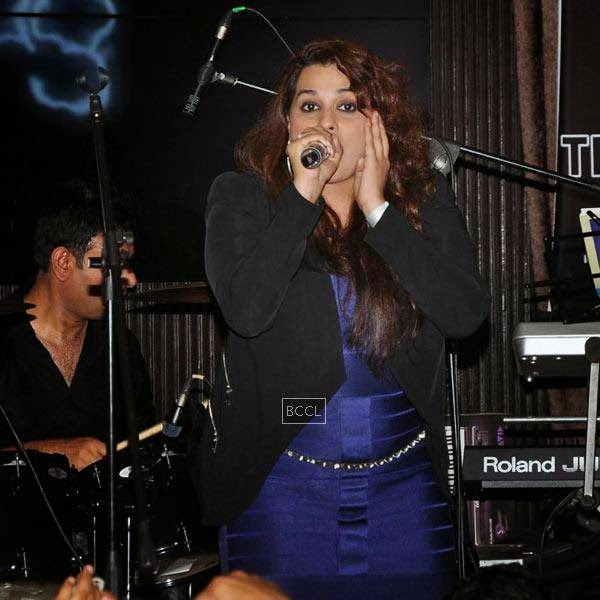An artist performs during Ankit Tiwari's live concert, held at Hard Rock Cafe, on July 11, 2014.(Pic: Viral Bhayani)