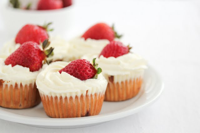 close-up photo of a plate of Strawberries and Cream Cupcakes
