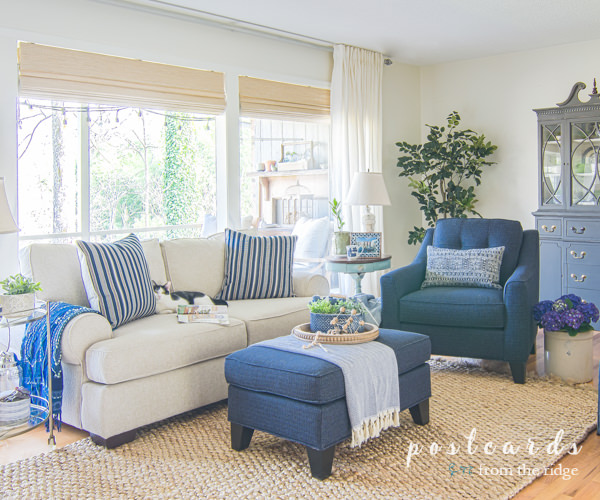 living room with blue and white furniture