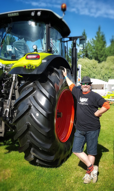 Photo of me next to a big tractor tyre at the 2016 Southern Fieldays