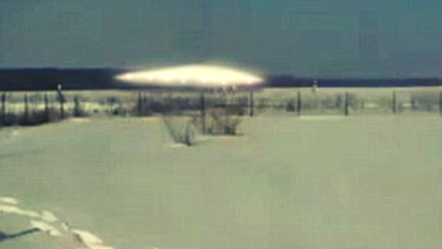 Here's the image that shows five Aliens around the landed UFO in Siberia.