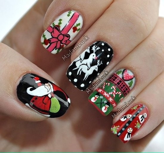 paint your nails with reds whites silvers and a lot of greens make it with a lot of christmas love