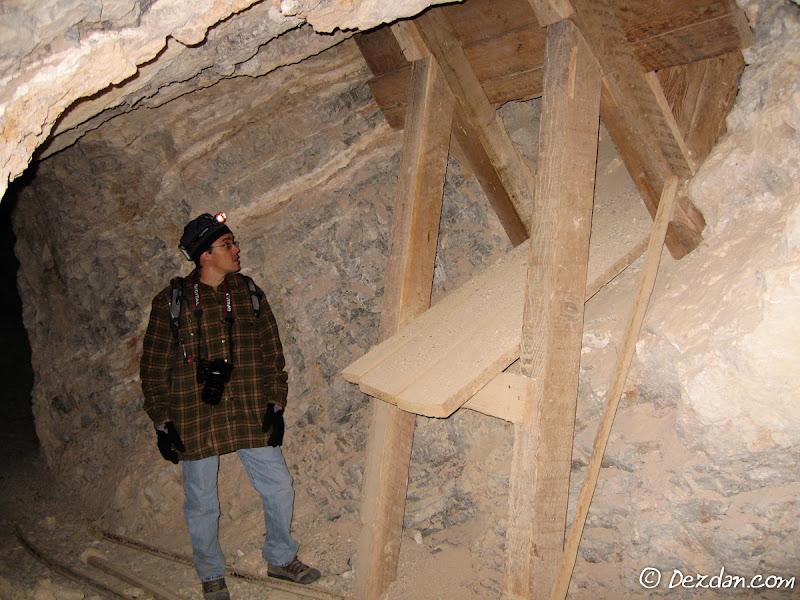 Guy at a primitive ore chute.