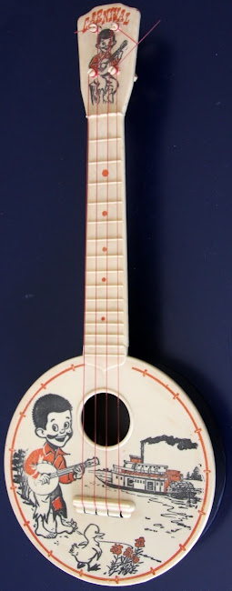 Carnival steamboat round piccolo at Lardys Ukulele Database