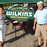 Sue Williams and Buzz Brown with a GWBHS booth at a Gino's Pre-Dream Cruise community event.