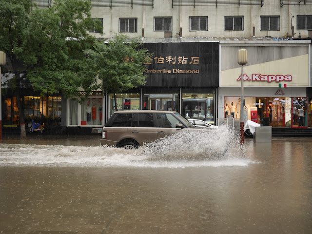 SUV driving on a flooded street in Taiyuan, China